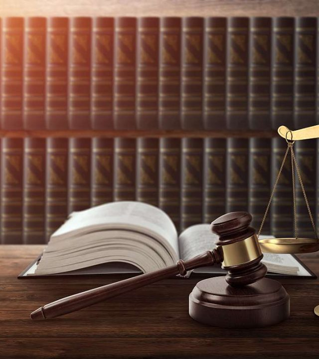 Judge's gavel and a book on a wooden table. Concept of law, justice, punishment, judge, corrupt court. copy space