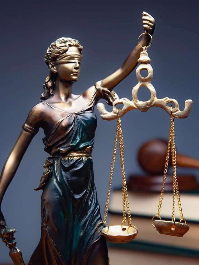 lady justice with books on table